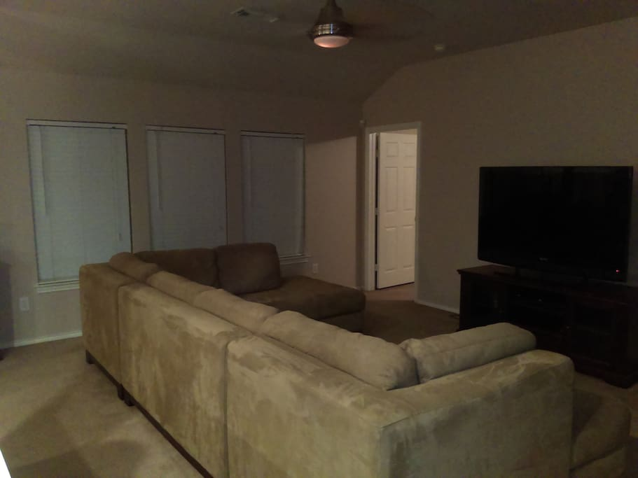Back view of Living quarters sofa and flat screen television to watch the game on