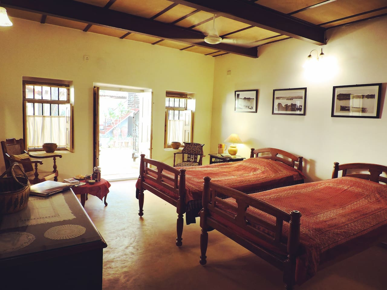 The bedroom is set with original furniture and beautiful Kutchi bedspreads.