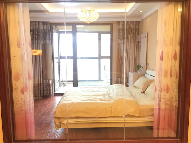 青岛近海公寓近金沙滩景区温馨套二房可做饭 - ชิงเต่า