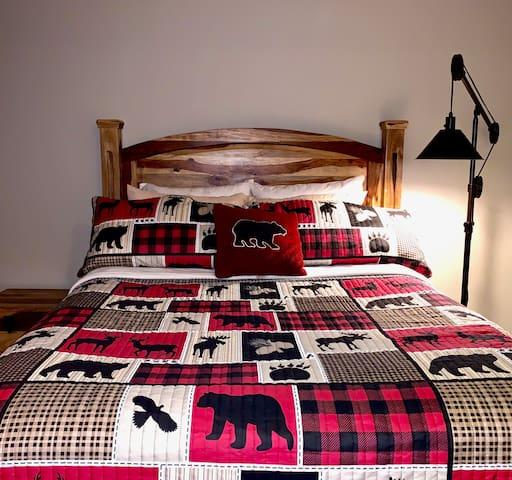 Queen bed located in second bedroom