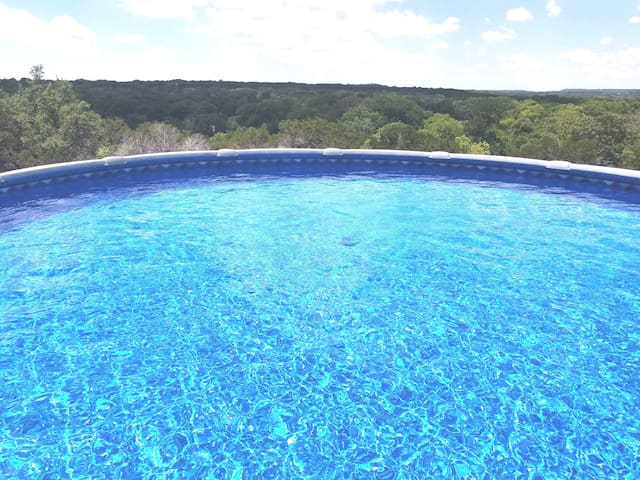 Pool with a view of the hills.