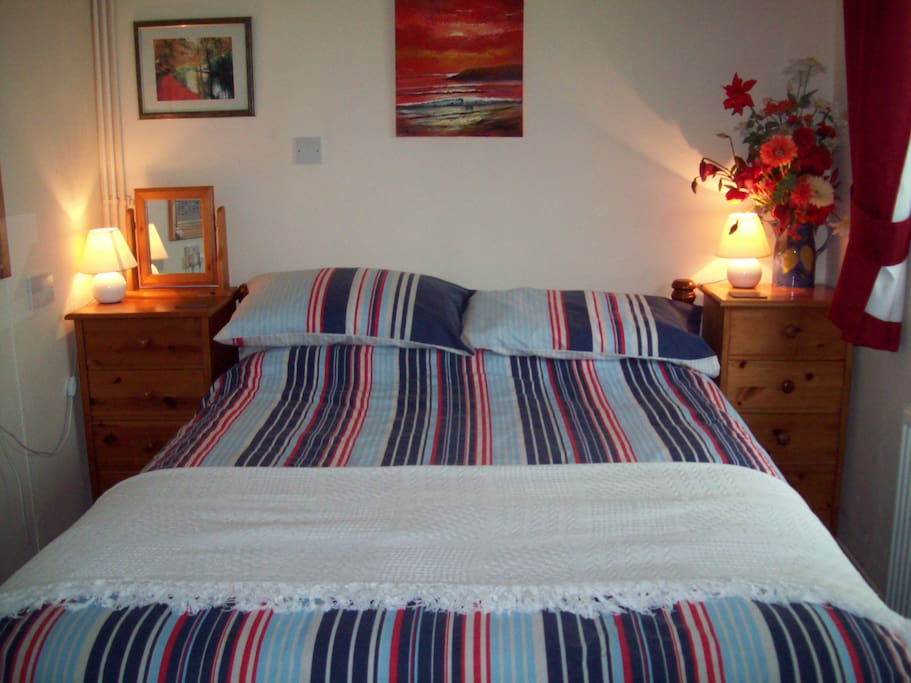 Sunny double bedroom with TV and freeview