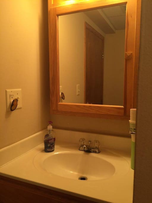 Bathroom sink & mirror.