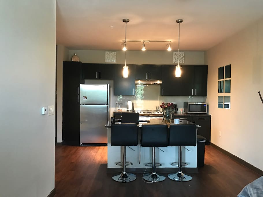 Kitchen with 3 barstools