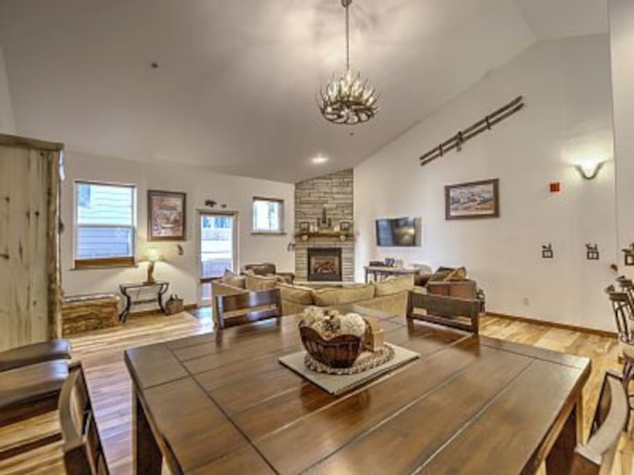 Great Room with stone fireplace, Murphy Bed, and deck.