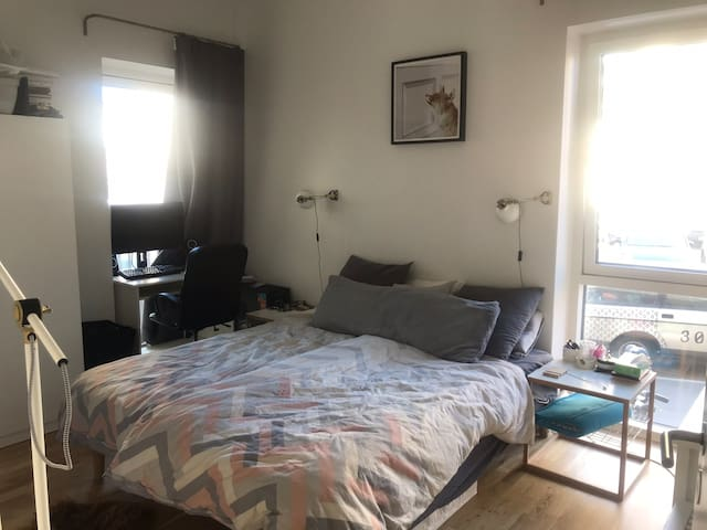 Master bedroom with queen bed, both plenty of light and black out curtains