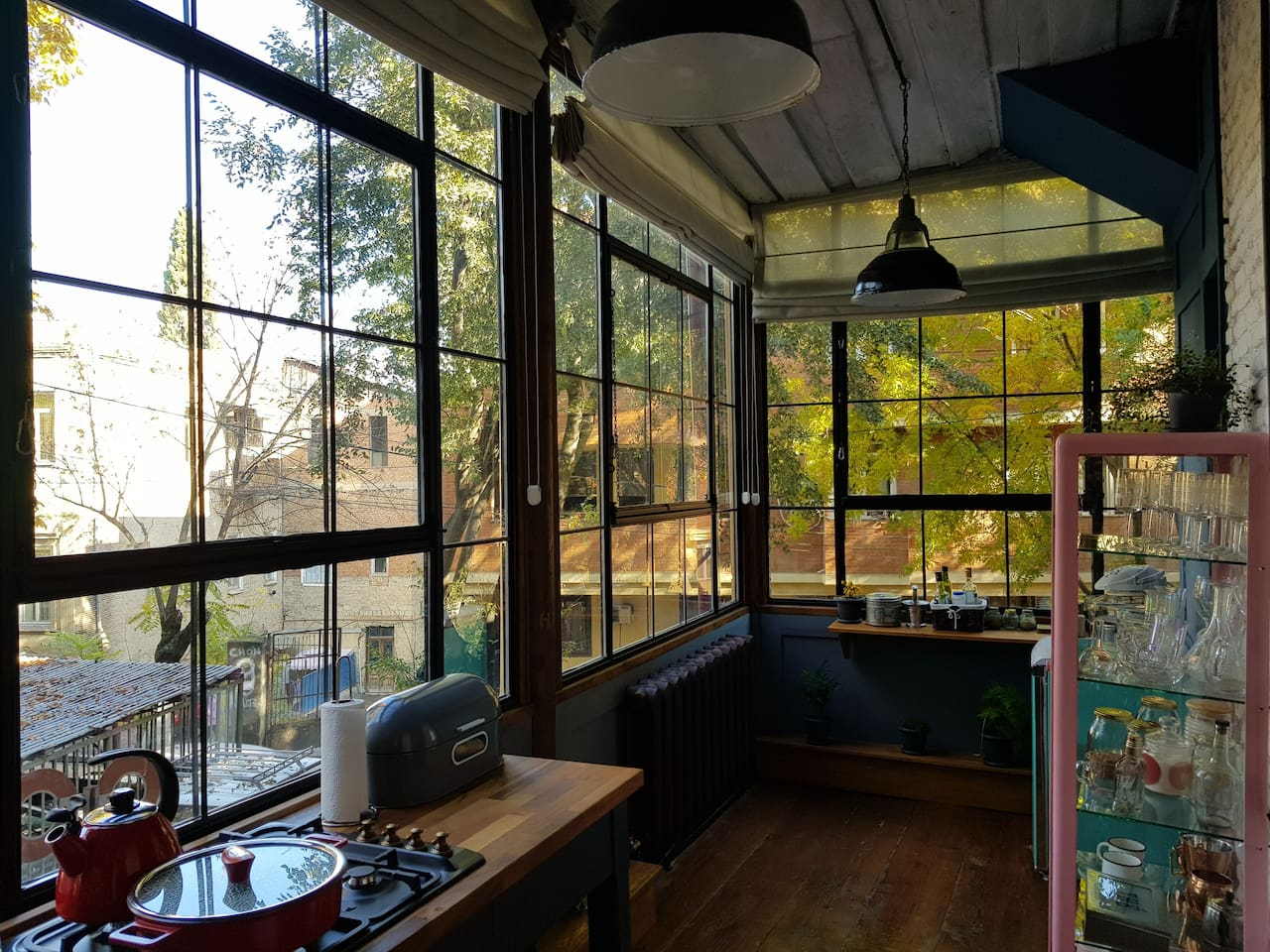 The kitchen windows have Roman curtains that can be closed for keeping the light out and for providing more privacy.