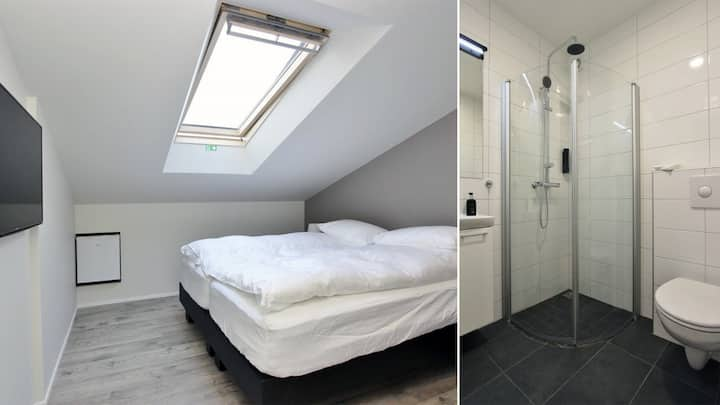 A Petite Double Room with a Skylight Window in Akureyri