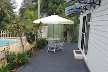 Excellent relaxing spot for your holiday. Privacy all around. You can hear the birds, waves and feel the breeze. This is your private yard. We give you complete privacy.
