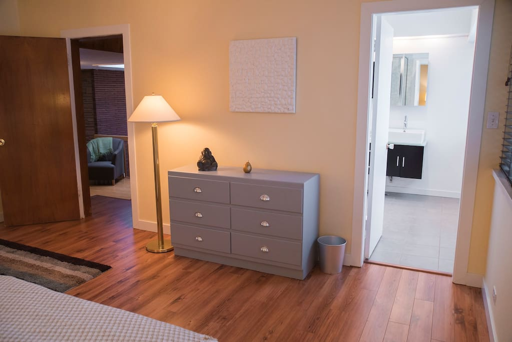 Your large sunny master bedroom - private bath door