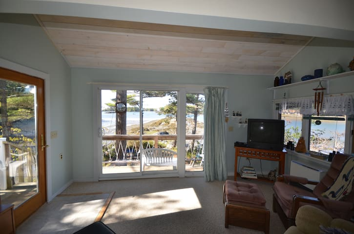 Front room with a view from all sides!  Sit back, relax and watch the tides roll in.