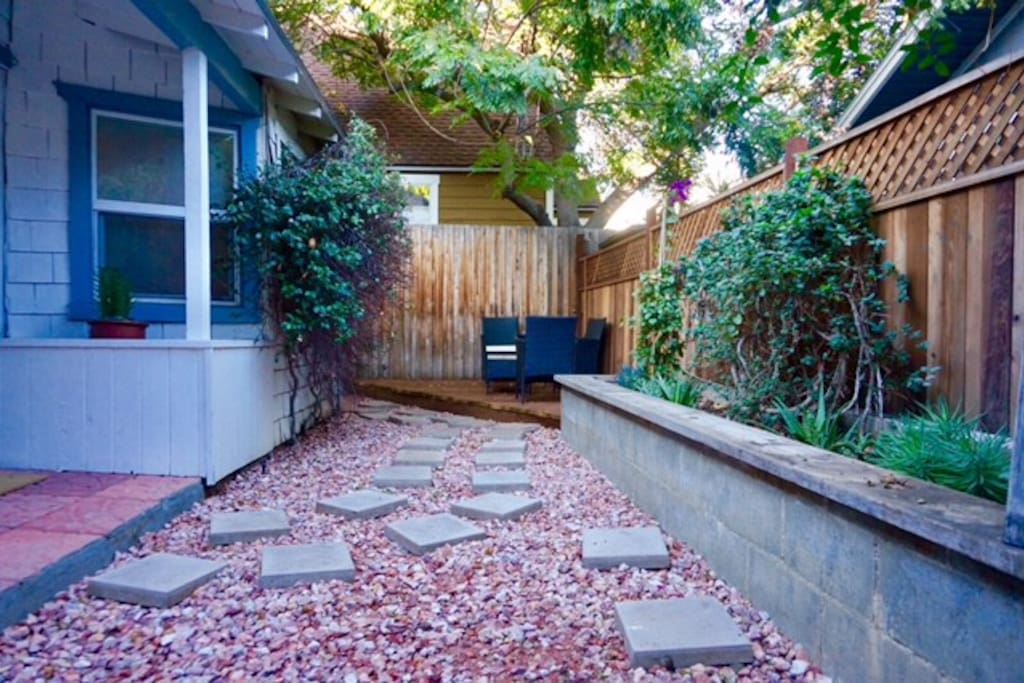 Private backyard, seating area, BBQ.