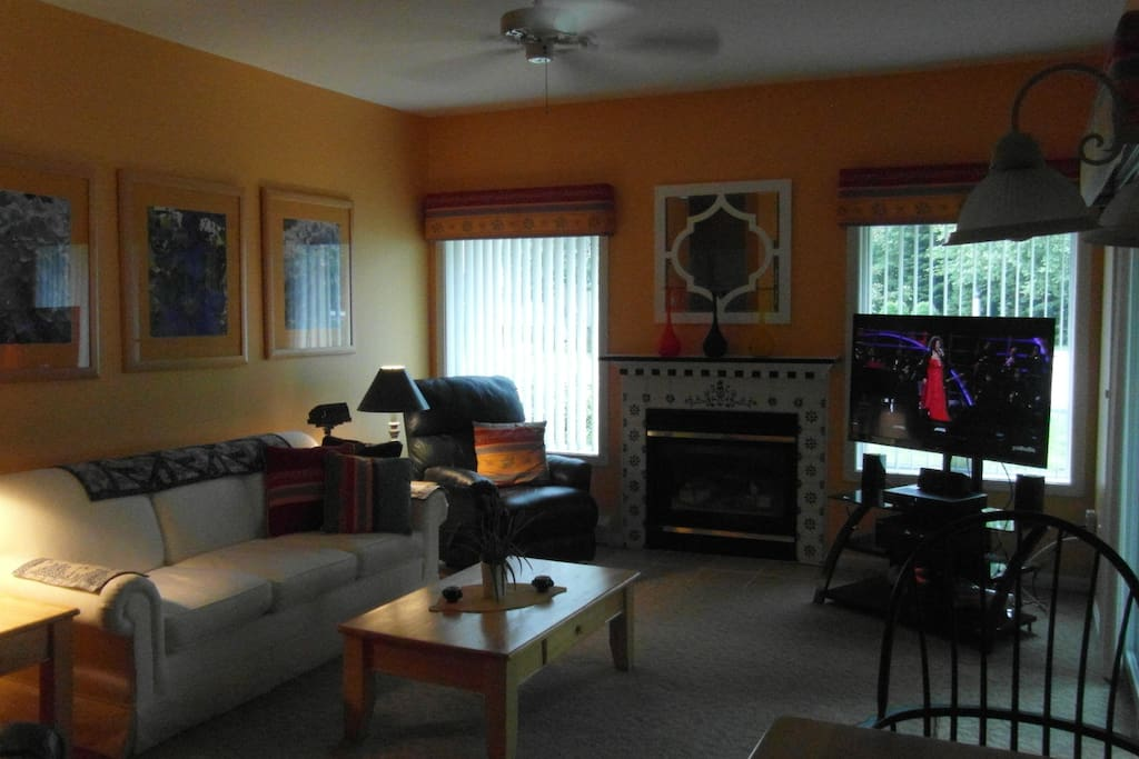 Living room with 2 leather chairs; one a recliner and the other a stress-less chair and ottoman along with a  queen size couch