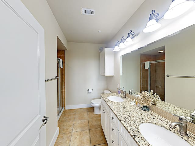 Enjoy the convenience of an en-suite master bathroom, configured with a double vanity and walk-in shower.