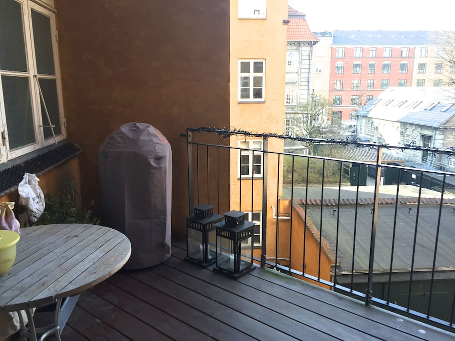 Large balcony with table and chairs