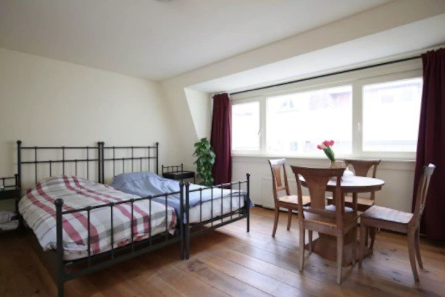 a light bedroom with convenient beds