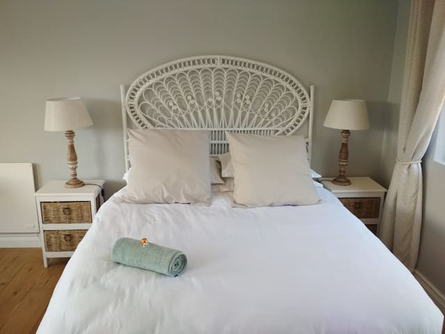 Queen size bed with feather topper
