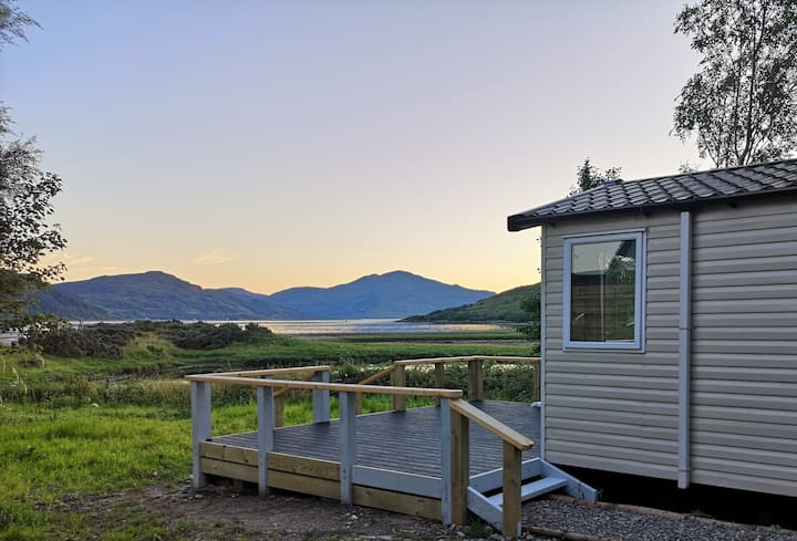 Shingle Bay, Modern caravan near castle and Skye.