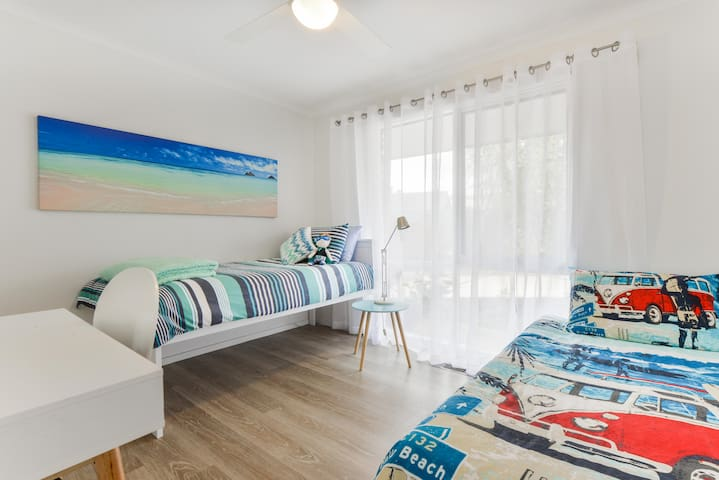 Light, airy bedroom 3 with 2 single beds & desk