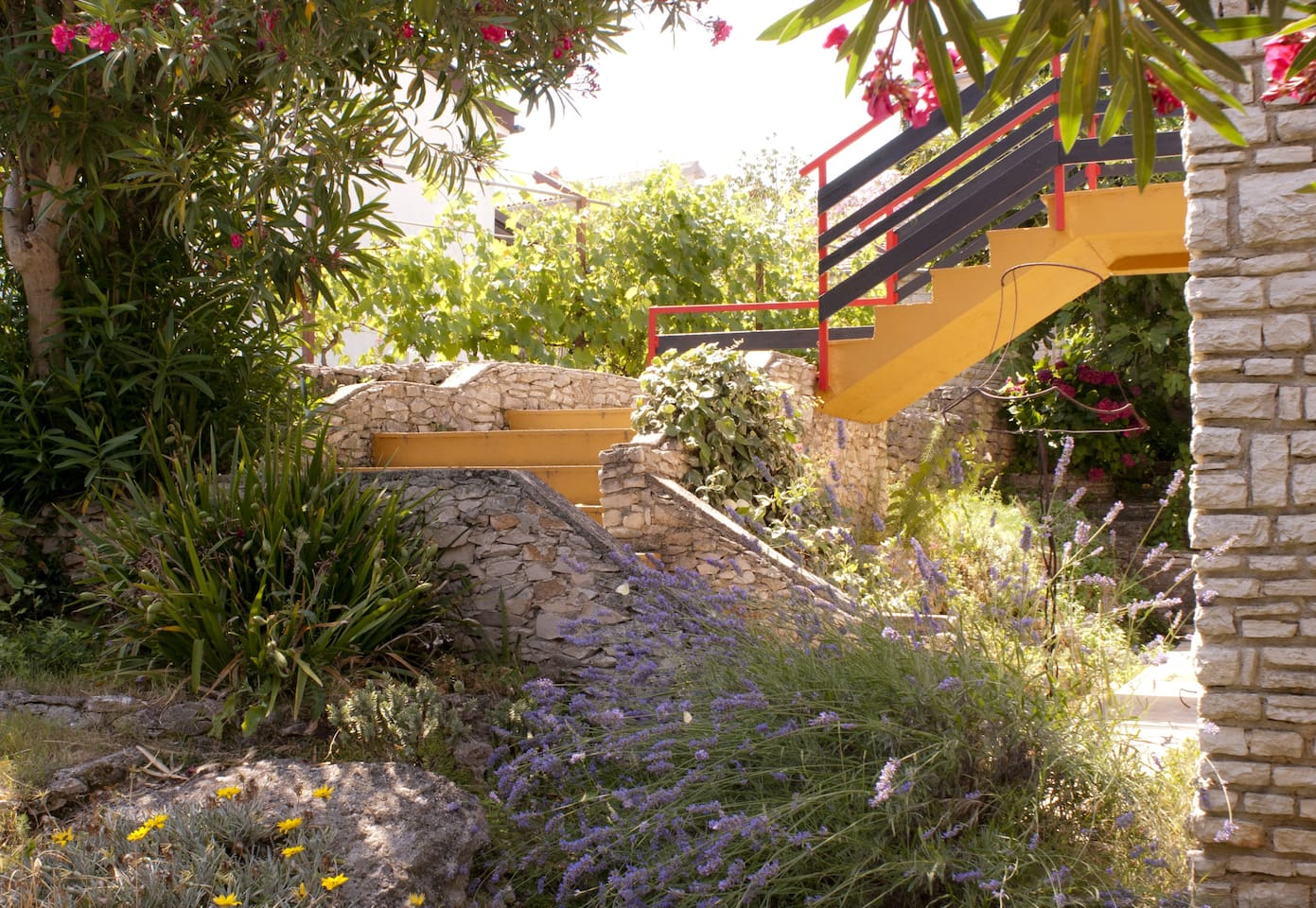 Outdoor staircases which lead to the apartment were conceived as a walk through the garden.