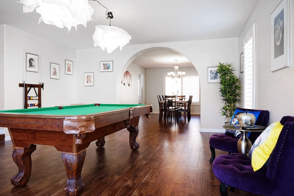 The game room features cool furniture and a pool table