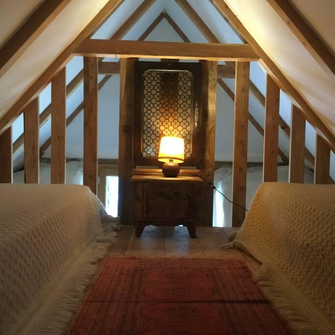 The upper mezzanine. It has 2 single beds