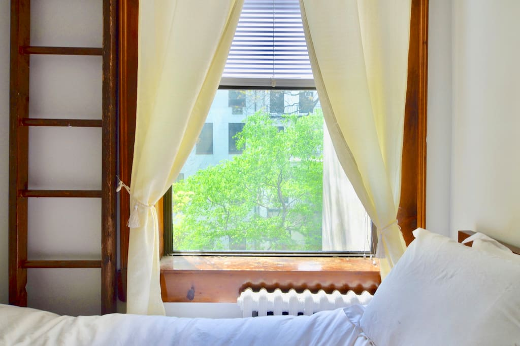 The bed looks out at the backyard of the building, so you will have a nice tree-lined view and minimal noise from the city.
