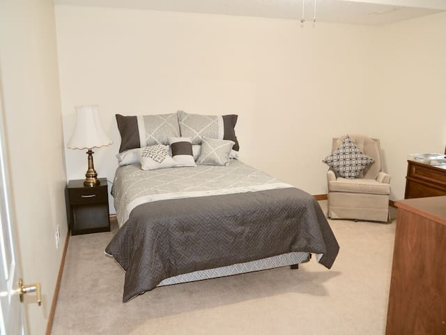 Large bedroom with double bed, a quiet room for the kids. Large closet and dresser. Cable TV and VHS available.