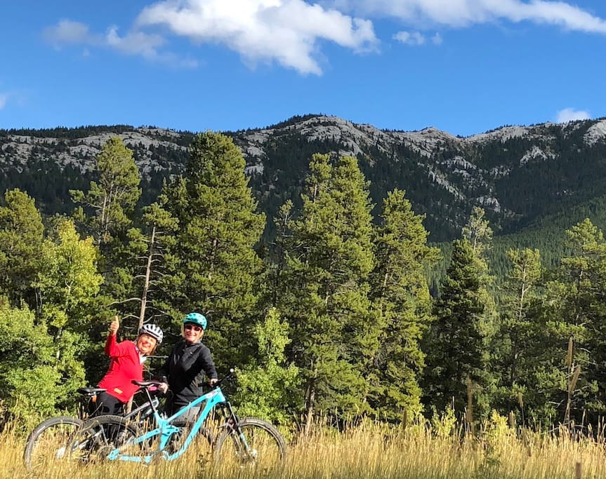 Riding up Pass Powder Keg Trails with Turtle Mtn in the background