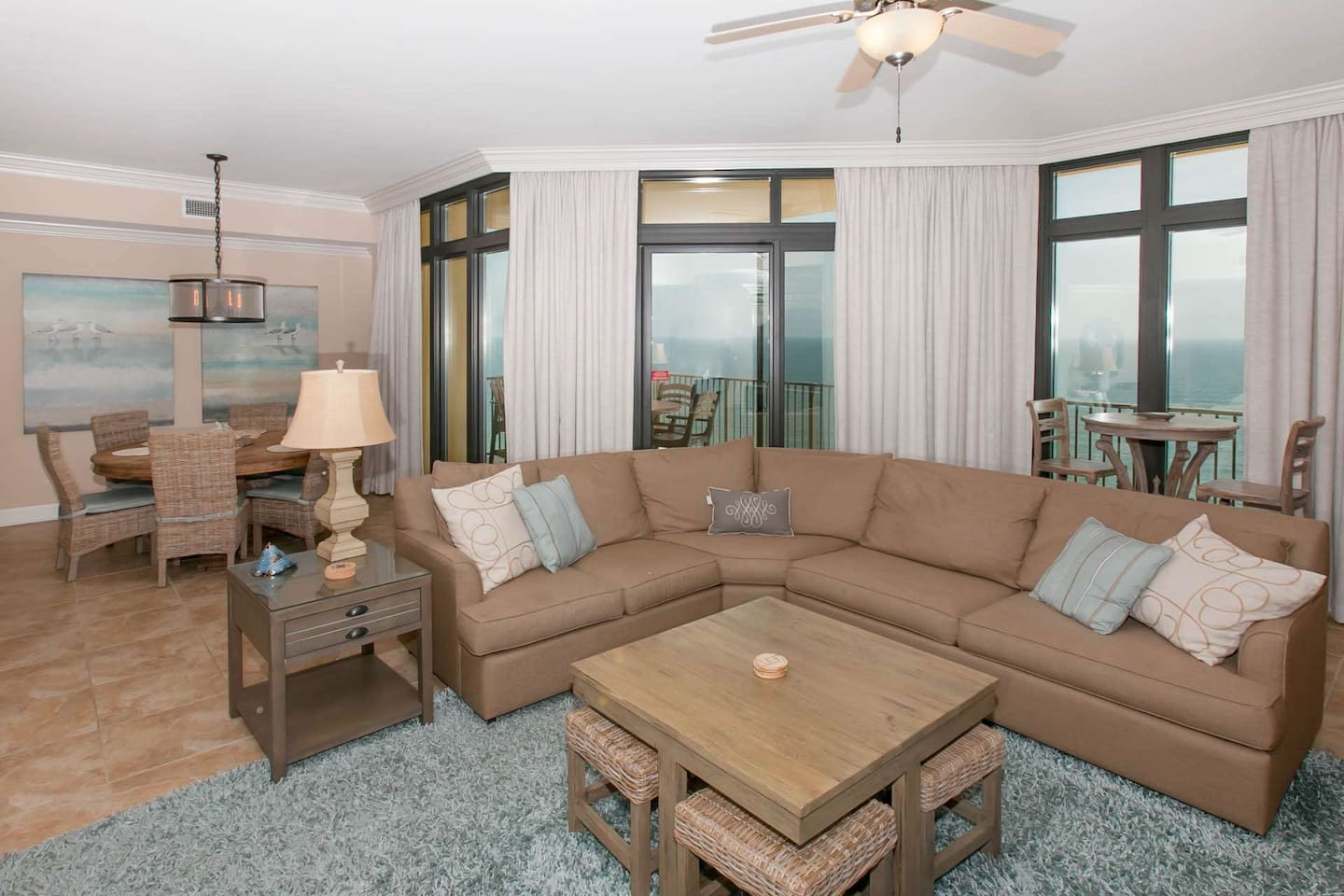 Living room with sectional sleep sofa overlooking 19th floor Gulf-front view