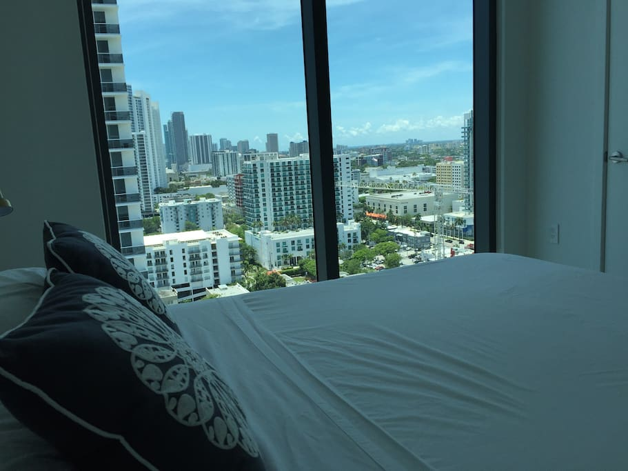 bedroom with bay and downtown views