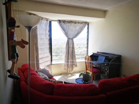 Acogedora  habitación en un apartamento