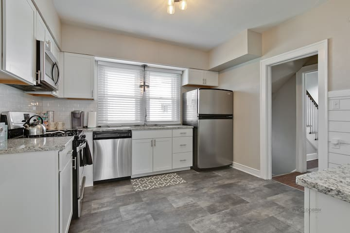 Fully stocked with everything you need to prepare an awesome home cooked meal for your family & friends, this newly remodeled kitchen has new cabinets, granite counter tops, ship lap and subway tile.  Lots of bowls & serving pieces are included.
