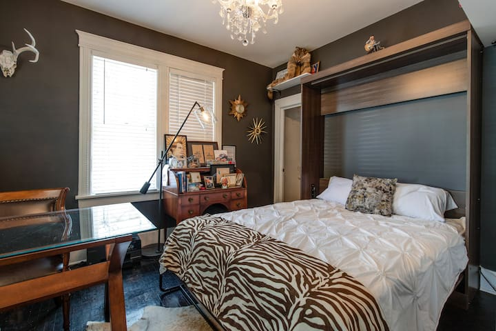 Our third downstairs room is perfect for a couple or friends, with a queen Murphy bed with the 3rd full bathroom right down the hall. This room also includes a crib.