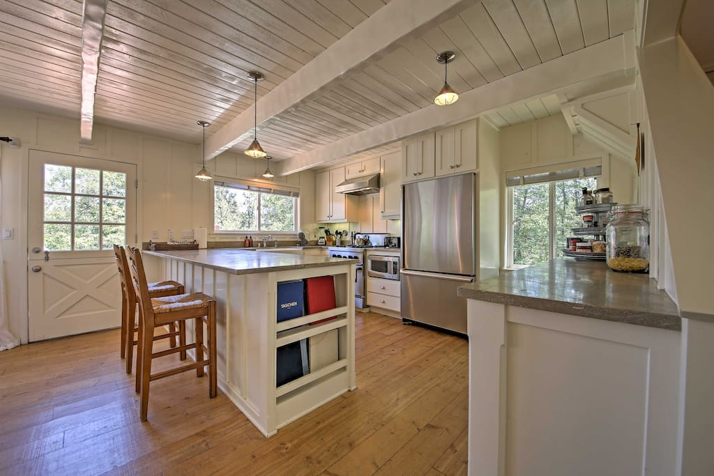 Inside, wood floors are beautifully contrasted with white walls and ceilings.