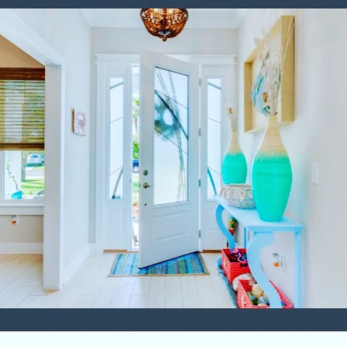 Entrance into foyer sets the stage for beach colors and all things sand & surf!