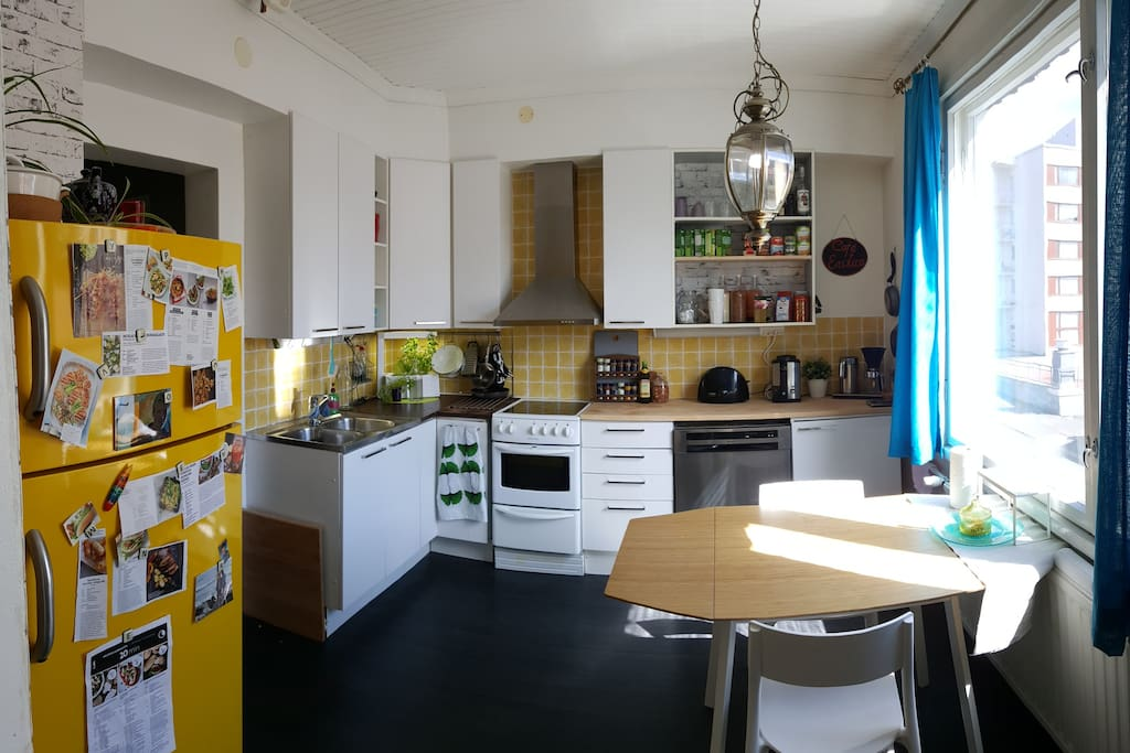 Kitchen has warm colors and is fully equipped to cook anything from Pad Thai to icecream