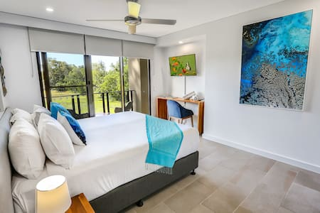 King Bed Bedroom private and has glimpses of the ocean from your private balcony