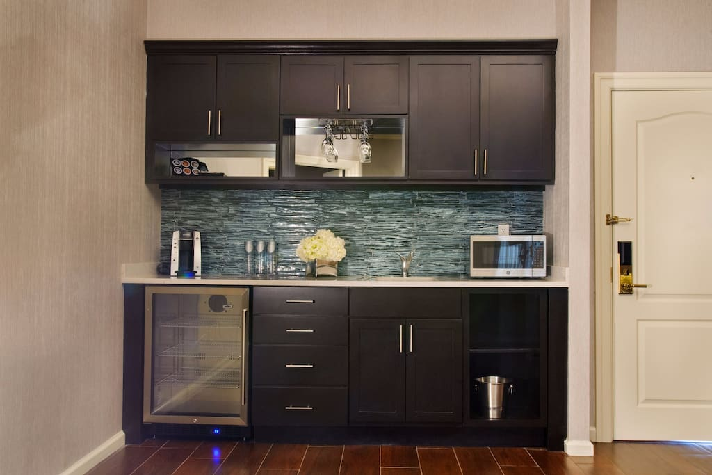 Kitchenette: microwave, fridge, Keurig coffee machine, glassware & flatware