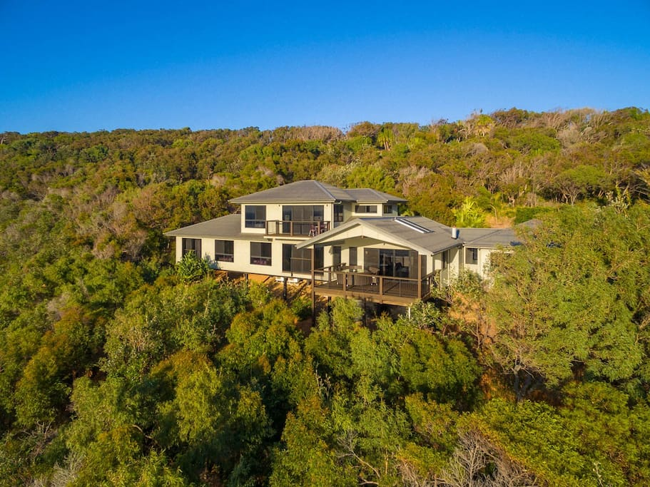 Nestled into a hillside within the confines of an exclusive gated enclave of just six homes, on 14 picturesque acres
