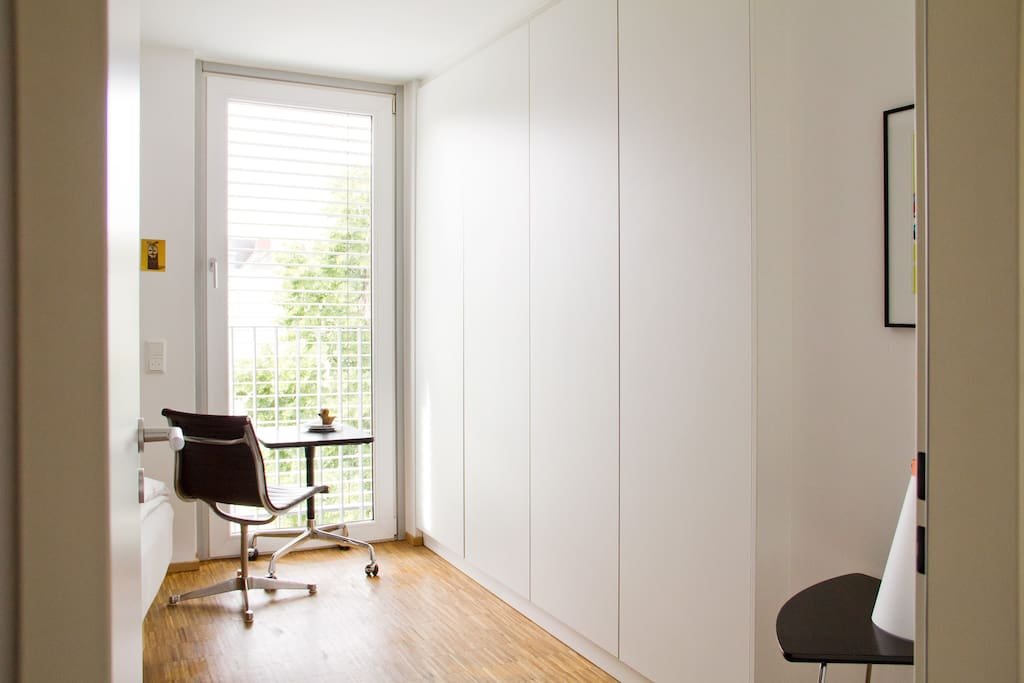 Your guestroom: A small Eames desk and chair for working at your laptop, while overlooking the beautiful urban backyard.