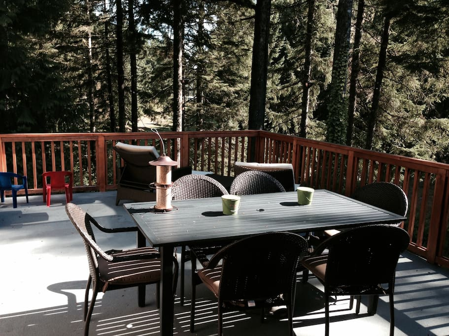 An enormous deck off the living room is perfect for summer time entertaining