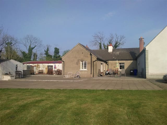 Garden/patio area (I live onsite in the pale house on the right of the picture)