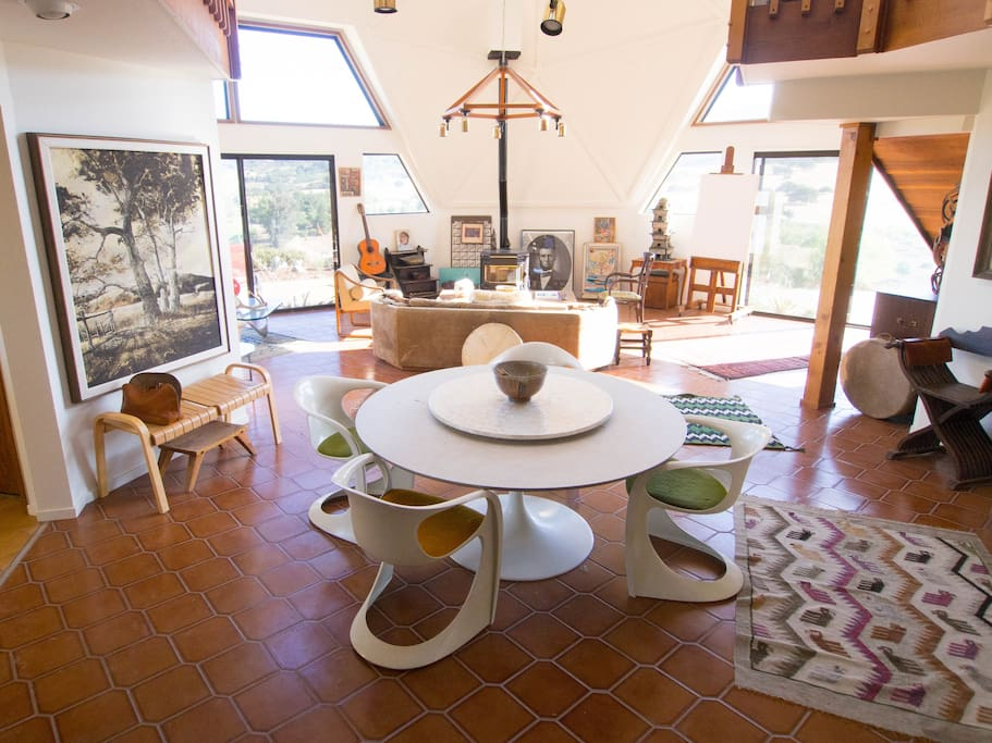 Living room and circular dining table facilitate creative conversation...