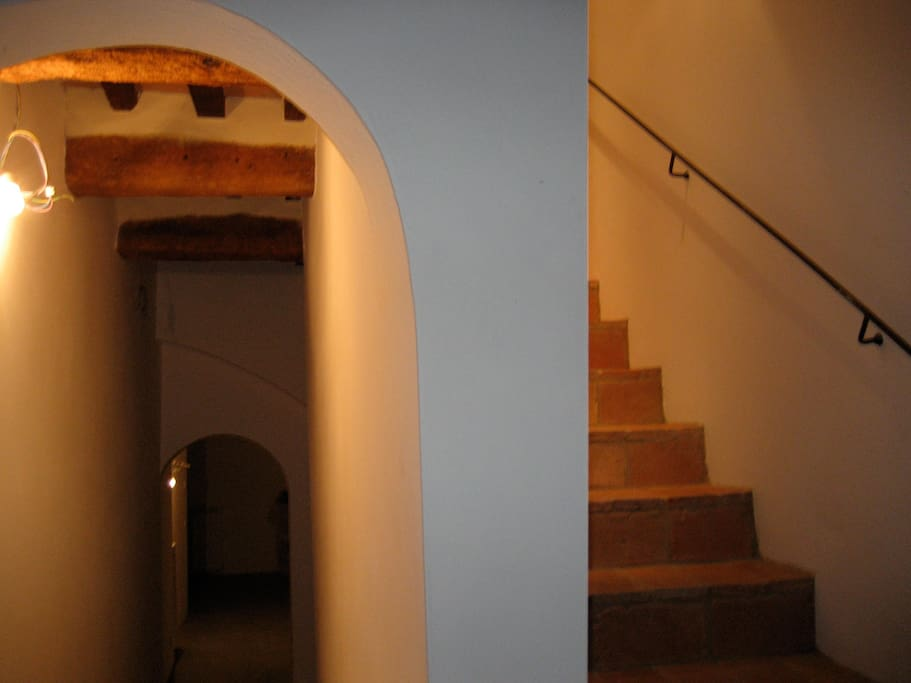 Left side is basement laundry (heated) and right is stairs to living room, (main house)