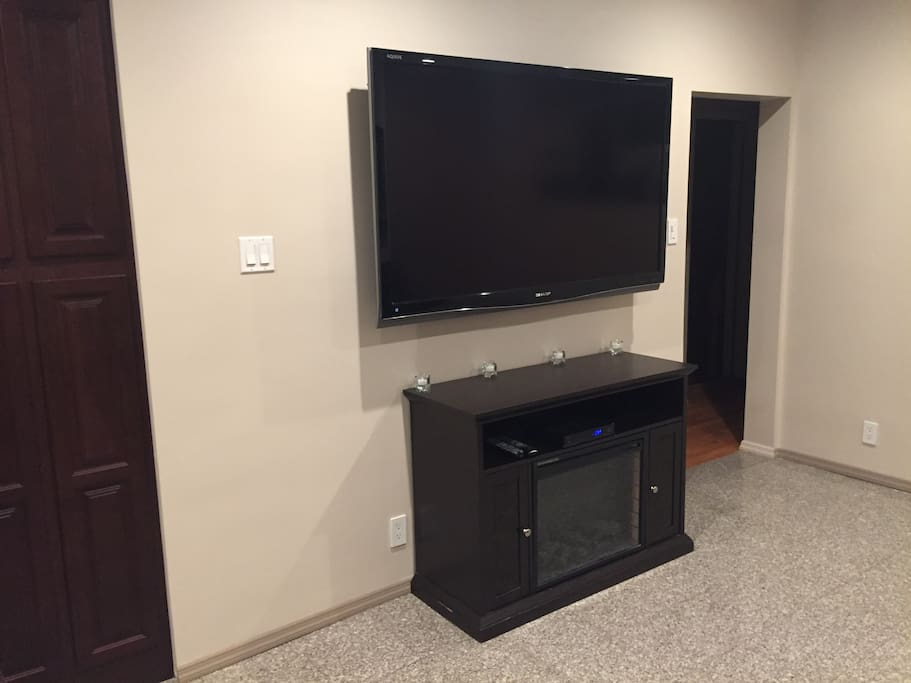 """65"""" Television and Electric fireplace"""