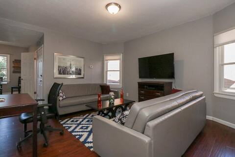 Lovely living space with a wall mounted TV, sofas and deskwork space!