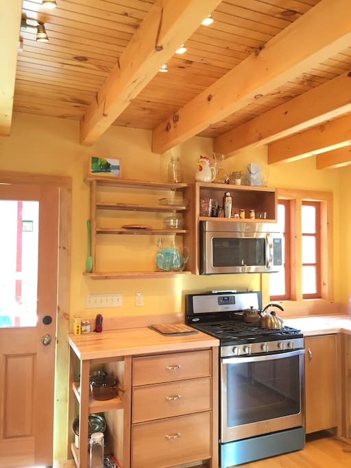 Maple butcher-block counters, oak floors and cabinets, gas stove and all new appliances.