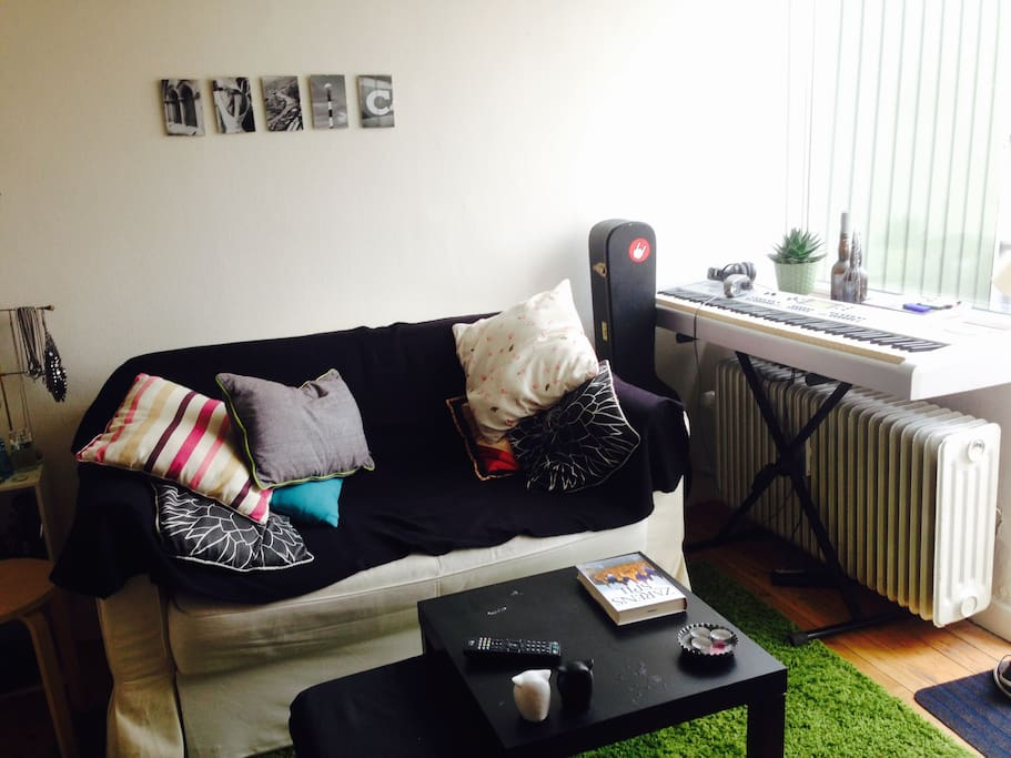 My sofa - which folds out into a bed - and my music corner...