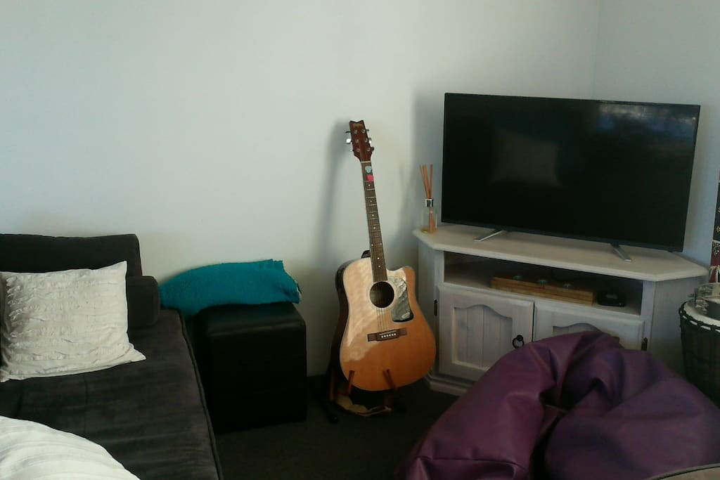Living room.  Jam on the guitar, or netflix? Your choice.